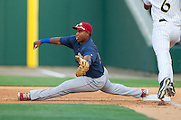 Lehigh Valley IronPigs first baseman Maikel Franco (10) stretches for a throw during the game against the Charlotte Knights at BB&T Ballpark on May 8, 2014 in Charlotte, North Carolina.  The IronPigs defeated the Knights 8-6.  (Brian Westerholt/Four Seam Images)