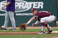 Texas A&M Aggies first baseman Cole Lankford (12) records a putout against the LSU Tigers in the NCAA Southeastern Conference baseball game on May 10, 2013 at Blue Bell Park in College Station, Texas. LSU defeated Texas A&M 7-4. (Andrew Woolley/Four Seam Images).