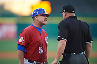 Buffalo Bisons manager Gary Allenson (5) talks with umpire James Rackley after a play at the plate during a game against the Louisville Bats on June 22, 2016 at Coca-Cola Field in Buffalo, New York.  Buffalo defeated Louisville 8-1.  (Mike Janes/Four Seam Images)