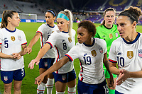 ORLANDO, FL - JANUARY 18: Crystal Dunn #19 of the USWNT puts her hand into the huddle before a game between Colombia and USWNT at Exploria Stadium on January 18, 2021 in Orlando, Florida.