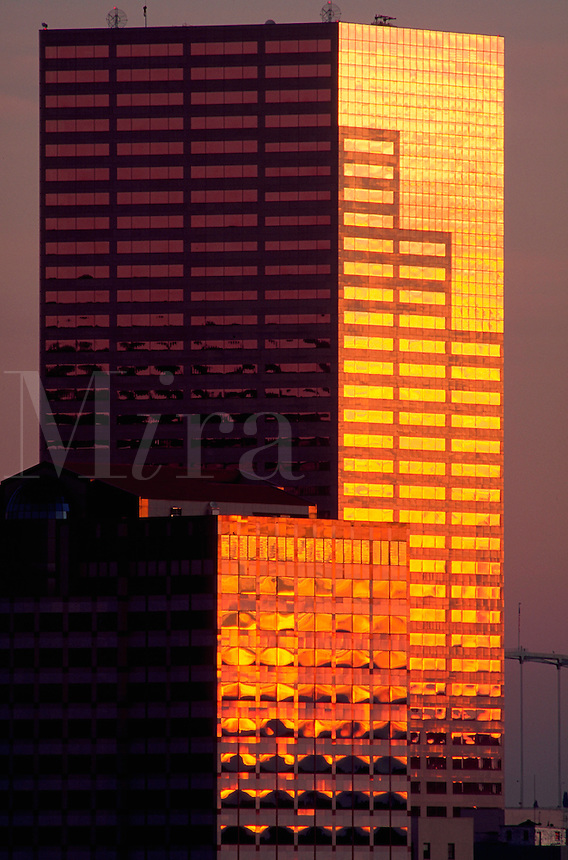 The exterior of the US Bancorp tower and One Financial Center building with the glow of early morning light reflected in the windows. Portland, Oregon.