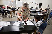 TressaKeeling, second grade artteacher, helps Elias Nava with an assignment, Monday, October 5, 2020 at Clinton Elementary School in Clinton. Check out nwaonline.com/2010010Daily/ for today's photo gallery. <br /> (NWA Democrat-Gazette/Charlie Kaijo)