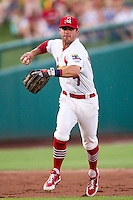 Greg Garcia (7) of the Springfield Cardinals prepares to throw to first base during a game against the Arkansas Travelers at Hammons Field on July 24, 2012 in Springfield, Missouri. (David Welker/Four Seam Images)