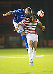 Hamilton Accies v St Johnstone...24.09.13      League Cup<br /> Frazer Wright gets above Mickael Antoine Curier<br /> Picture by Graeme Hart.<br /> Copyright Perthshire Picture Agency<br /> Tel: 01738 623350  Mobile: 07990 594431