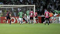 BOGOTA - COLOMBIA: 27-07-2016: Miguel Borja (Der.) jugador de Atletico Nacional de Colombia anota gol a Libardo Azcona (Cent.) portero de Independiente Del Valle de Ecuador, durante partido de vuelta de la final, entre Atletico Nacional e Independiente Del Valle por la Copa Bridgestone Libertadores 2016 en el Estadio Atanasio Girardot, de la ciudad de Medellin. / Miguel Borja (R) player of Atletico Nacional of Colombia, scored a goal to Libardo Azcona (C) goalkeeper of Independiente Del Valle de Ecuador, during a match for the second leg for the final between Atletico Nacional and Independiente Del Valle for the Bridgestone Libertadores Cup 2016, in the Atanasio Girardot Stadium, in Medellin city. Photos: VizzorImage / Luis Ramirez / Staff.
