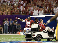 C.J. Mosley of Alabama points to the fans after injures his leg from intercepting the ball during BCS National Championship game against LSU at Mercedes-Benz Superdome in New Orleans, Louisiana on January 9th, 2012.   Alabama defeated LSU, 21-0.
