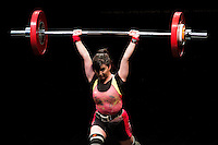 10 MAY 2014 - COVENTRY, GBR - Shila Panjavi from Stars for the Future attempts to complete a lift during the women's 58kg category round at the British 2014 Senior Weightlifting Championships and final 2014 Commonwealth Games qualifying event round at the Ricoh Arena in Coventry, Great Britain (PHOTO COPYRIGHT © 2014 NIGEL FARROW, ALL RIGHTS RESERVED)