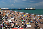 Great Britain, England, East Sussex, Brighton: View along busy beach to Brighton Pier