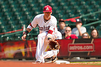 First baseman Dominic Ficociello #25 of the Arkansas Razorbacks fields a low throw against the Texas Tech Red Raiders at Minute Maid Park on March 2, 2012 in Houston, Texas.  The Razorbacks defeated the Red Raiders 3-1.  Brian Westerholt / Four Seam Images