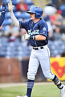 Asheville Tourists left fielder Will Golsan (8) celebrates after hitting a  home run during a game against the West Virginia Power at McCormick Field on April 18, 2019 in Asheville, North Carolina. The Power defeated the Tourists 12-7. (Tony Farlow/Four Seam Images)