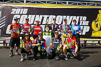 Sep 18, 2016; Concord, NC, USA; (front row from left) NHRA pro stock motorcycle riders Angelle Sampey , Eddie Krawiec , Matt Smith , Cory Reed (back row from left) Chip Ellis , Hector Arana Jr , Hector Arana Sr , Andrew Hines , L.E. Tonglet and Jerry Savoie pose for a group photo with the championship trophy during the Carolina Nationals at zMax Dragway. Mandatory Credit: Mark J. Rebilas-USA TODAY Sports
