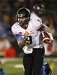 Boise State quarterback Grant Hedrick (9) runs against Nevada in the first half of an NCAA college football game in Reno, Nev., on Saturday, Oct. 4, 2014. Boise State won 51-46. (AP Photo/Cathleen Allison)