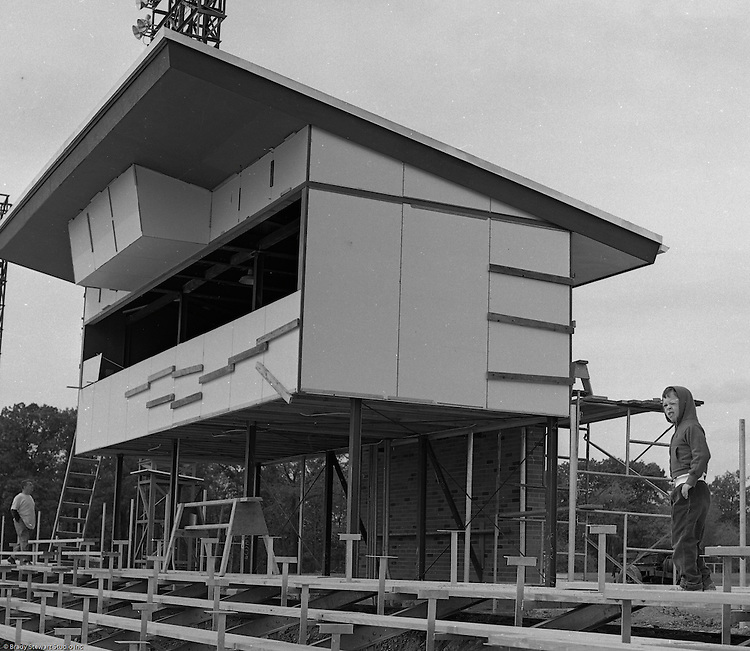 Bethel Park Senior High School:  View of the ongoing construction of the new High School Football Stadium.  Patrick Stewart was assisting Brady Stewart on the assignment.  The new Bethel Senior High School was dedicated on October 23, 1960, but the campus would not grow to its current size until seven years later. Phase II of the construction was completed in 1964 with the addition of another academic building and the industrial arts building. Phase III was completed in 1967 with the construction of the fourth academic building and a 6,300 seat football stadium and track, three tennis courts, seven basketball courts, and a baseball field.
