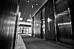 Person leaving work at the Kettering Tower and passing through the revolving door.