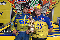 Jun. 2, 2013; Englishtown, NJ, USA: NHRA funny car driver Matt Hagan (left) and Alex Conaway celebrates after winning the Summer Nationals at Raceway Park. Mandatory Credit: Mark J. Rebilas-