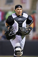 Kannapolis Intimidators catcher Wilfredo Rodriguez (37) jogs off the field between innings of the game against the Hickory Crawdads at Kannapolis Intimidators Stadium on April 22, 2017 in Kannapolis, North Carolina.  The Intimidators defeated the Crawdads 10-9 in 12 innings.  (Brian Westerholt/Four Seam Images)