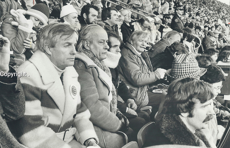 1978 FILE PHOTO - ARCHIVES -<br /> <br /> Premiers Peter Lougheed (left) of Alberta, Rene Levesque of Quebec and Bill Davis (right) at game held at Exhibition Stadium of Toronto. <br /> <br /> PHOTO : Ron BULL - Toronto Star Archives - AQP