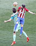 Atletico de Madrid's Yannick Ferreira Carrasco (r) and FC Barcelona's Sergi Roberto during La Liga match. February 26,2017. (ALTERPHOTOS/Acero)