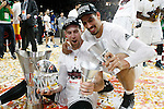 Real Madrid's Andres Nocioni (l) and Gustavo Ayon celebrate the victory in the Euroleague Final Match. May 15,2015. (ALTERPHOTOS/Acero)