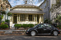 New Orleans, Louisiana.  Double Shotgun-style House in the Uptown District.  Duplex,  Two Doors Flanking Two Windows.