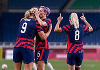 SAITAMA, JAPAN - JULY 24: Lindsey Horan #9 of the USWNT celebrates her goal with Megan Rapinoe #15 during a game between New Zealand and USWNT at Saitama Stadium on July 24, 2021 in Saitama, Japan.