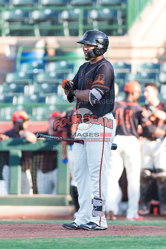 AZL Giants Orange right fielder Franklin Labour (49) at bat during an Arizona League game against the AZL Rangers at Scottsdale Stadium on August 4, 2018 in Scottsdale, Arizona. The AZL Giants Black defeated the AZL Rangers by a score of 3-2 in the first game of a doubleheader. (Zachary Lucy/Four Seam Images)