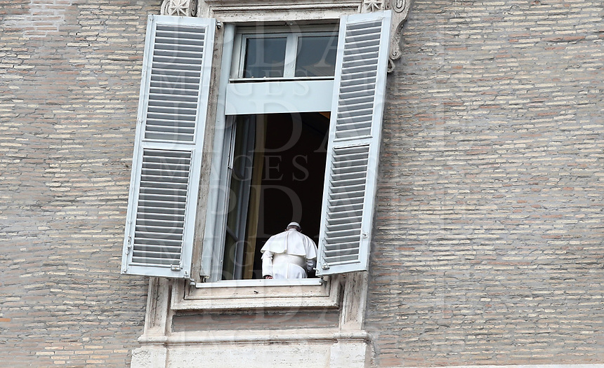Pope Francis gets back in after appearing to deliver his blessing at the window of the Apostolic palace on April 13, 2020 in the Vatican, after delivering his message during a private Angelus prayer live broadcast from the palace's library on Easter Monday, during the lockdown aimed at curbing the spread of the COVID-19 infection, caused by the novel coronavirus.<br /> UPDATE IMAGES PRESS/Isabella Bonotto<br /> <br /> STRICTLY ONLY FOR EDITORIAL USE