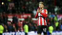 Emiliano Marcondes of Brentford applauds the home fans at the end of the match during Brentford vs Leeds United, Sky Bet EFL Championship Football at Griffin Park on 11th February 2020
