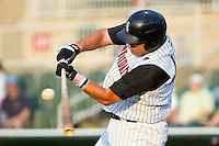 Dan Black #40 of the Kannapolis Intimidators takes his cuts against the Greenville Drive at Fieldcrest Cannon Stadium on May 8, 2011 in Kannapolis, North Carolina.   Photo by Brian Westerholt / Four Seam Images