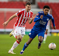 9th January 2021; Bet365 Stadium, Stoke, Staffordshire, England; English FA Cup Football, Carabao Cup, Stoke City versus Leicester City; Sam Vokes of Stoke City and Wesley Fofana of Leicester City chase a loose ball Strictly Editorial Use Only. No use with unauthorized audio, video, data, fixture lists, club/league logos or 'live' services. Online in-match use limited to 120 images, no video emulation. No use in betting, games or single club/league/player publications