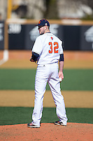 Bucknell Bison relief pitcher Jordan Holtz (32) looks to his catcher for the sign against the Georgetown Hoyas at Wake Forest Baseball Park on February 14, 2015 in Winston-Salem, North Carolina.  The Hoyas defeated the Bison 8-5.  (Brian Westerholt/Four Seam Images)
