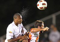 Daniel Paladini #11 Of the Carolina Railhawks loses a header to Chris Nurse #8 of the Puerto Rico Islanders during the second leg of the USSF-D2 championship match at WakeMed Soccer Park, in Cary, North Carolina on October 30 2010. The game ended 1-1, Puerto Rico won on overall goals 3-1.