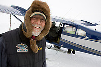 Pilot Bill Mayer brings a load of groceries and personnel to Shaktoolik on Monday during Iditarod 2008