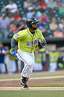 Left fielder Walter Rasquin (22) of the Columbia Fireflies runs toward first base in a game against the Charleston RiverDogs on Saturday, April 6, 2019, at Segra Park in Columbia, South Carolina. Columbia won, 3-2. (Tom Priddy/Four Seam Images)