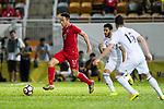 Lo Kong Wai of Hong Kong (L) in action during the International Friendly match between Hong Kong and Jordan at Mongkok Stadium on June 7, 2017 in Hong Kong, China. Photo by Marcio Rodrigo Machado / Power Sport Images