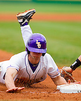 Austin Nola #36 of the LSU Tigers slides head first into third base against the LSU Tigers at Alex Box Stadium on February 19, 2011 in Baton Rouge, Louisiana.  The Tigers defeated the Demon Deacons 4-3.  Photo by Brian Westerholt / Four Seam Images