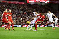 Jefferson Montero is tackled by Jordan Ibe during the Barclays Premier League Match between Liverpool and Swansea City played at Anfield, Liverpool on 29th November 2015