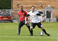 Pictured L-R: Garry Monk against Chris Barney. Tuesday 06 May 2014<br /> Re: Members of the local press play football against Swansea City FC coaches and members of staff at the Club's training ground in Fairwood, south Wales.