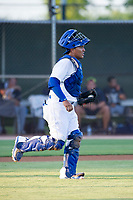 AZL Dodgers catcher Jair Camargo (8) jogs to the mound during a game against the AZL Brewers on July 25, 2017 at Camelback Ranch in Glendale, Arizona. AZL Dodgers defeated the AZL Brewers 8-3. (Zachary Lucy/Four Seam Images)
