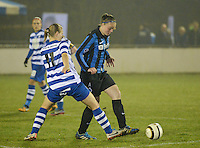 20140326 - AALTER , BELGIUM : Brugge's Tine De Caigny (r) pictured with Gent Maaike Trommelmans (l) during the soccer match between the women teams of Club Brugge Vrouwen  and AA Gent  Ladies , on the 21th matchday of the BeNeleague competition Friday 14 March 2014 in Aalter. PHOTO DAVID CATRY