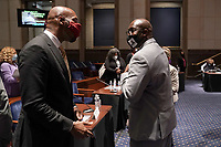 Paul Butler, law professor at Georgetown University Law Center, elbow bumps Philonise Floyd, brother of George Floyd, after aUnited States House Judiciary Committee hearing to discuss police brutality and racial profiling on Wednesday, June 10, 2020.<br /> Credit: Greg Nash / Pool via CNP/AdMedia