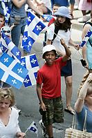 Defile de la St-Jean Baptiste, le 24 Juin 2005, sur la rue Notre-Dame Ouest, dans le Vieux-Montreal<br /> <br /> PHOTO : Agence Quebec Prese
