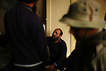 Sirte, LIBYA: Monday 11th October 2011:..A suspected Gaddafi loyalist soldier, center, is questioned by rebel fighters after being found in a house in Sirte. ...Ayman Oghanna