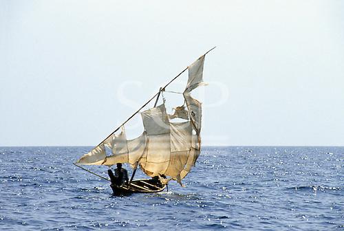 Tanzania. Dhow with ragged sail on Lake Tanganyika.