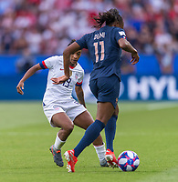 PARIS,  - JUNE 28: Crystal Dunn #19 defends Kadidiatou Diani #11 during a game between France and USWNT at Parc des Princes on June 28, 2019 in Paris, France.