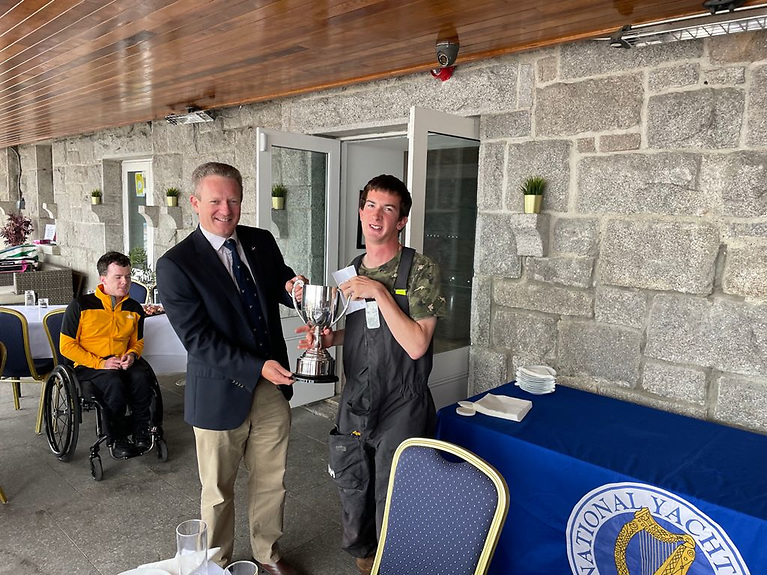 Patrick Hassett (right) is congratulated by National Yacht Club Commodore Conor O'Regan for his overall win of the 2.4mR Nationals (Para division) at Dun Laoghaire Harbour