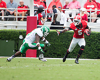The Georgia Bulldogs played North Texas Mean Green at Sanford Stadium.  After North Texas tied the game at 21 early in the second half, the Georgia Bulldogs went on to score 24 unanswered points to win 45-21.  Georgia Bulldogs cornerback Damian Swann (5) avoids a tackle by North Texas Mean Green defensive back David Busby (5)