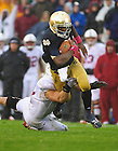 Oct. 13, 2012; Quarterback Everett Golson is tackled by Stanford Shayne Skov during the first half. Photo by Barbara Johnston/University of Notre Dame