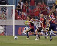 Real Salt Lake midfielder Ned Grabavoy (20) dribbles as Toronto FC midfielder Sam Cronin (2) defends. Salt Lake Real defeated Toronto FC, 3-0, at Rio Tinto Stadium on June 27, 2009.