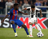 Football Soccer: UEFA Champions UEFA Champions League quarter final first leg Juventus-Barcellona, Juventus stadium, Turin, Italy, April 11, 2017. <br /> Juventus Dani Alves (r) in action with Barcellona's Samuel Umtiti (l) during the Uefa Champions League football match between Juventus and Barcelona at the Juventus stadium, on April 11 ,2017.<br /> UPDATE IMAGES PRESS/Isabella Bonotto